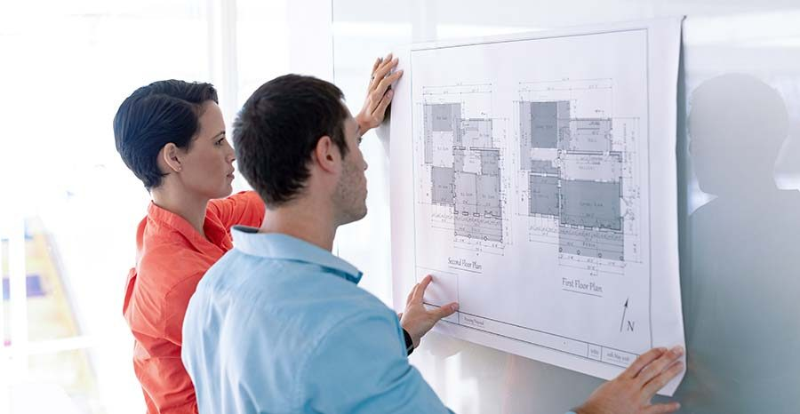 side-view-of-caucasian-architects-discussing-over--S8EWFT7